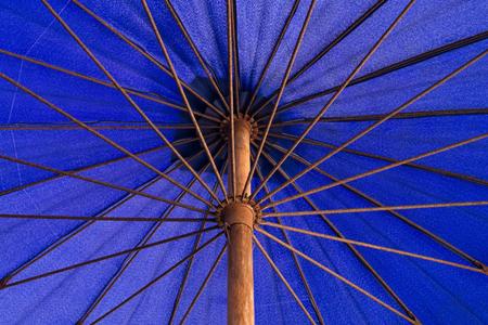 long handled: Under a long-handled blue umbrella nylon . Stock Photo