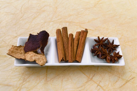 tangerine peel: Top view of dried tangerine peel, cinnamon sticks and star anise - herbs and spices.