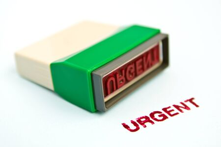urgent letter on green rubber stamp isolated on white background  photo