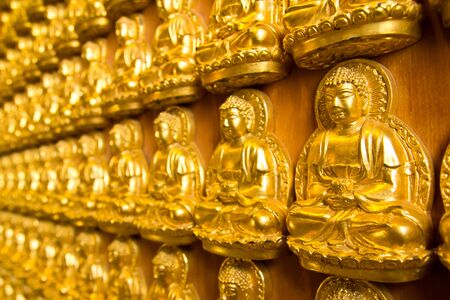 Stock Photo: Many small Buddha statue on the wall at chinese temple, Thailand photo