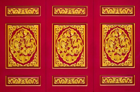 golden dragon on red background in chinese temple, Thailand  photo