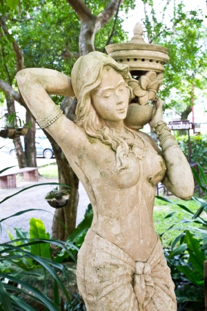 hindu temple: sandstone statue of woman, spa decorate