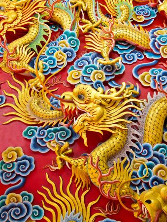 feng: chinese dragon on temple wall Editorial