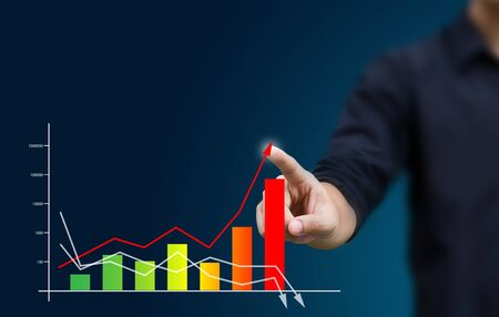 economic growth: a Business hand pressing a chart Stock Photo