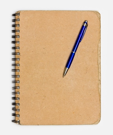 recycled paper notebook front cover with a pen photo