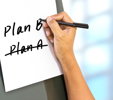adaptation: Business plan strategy changing  hand crossing over Plan A, writing Plan B  Stock Photo
