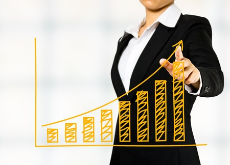 upward graph: business woman drawing a graph Stock Photo