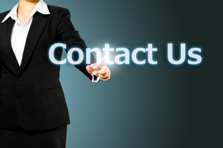 Business hand touch contact us Stock Photo - 14627049