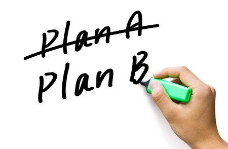 Business plan strategy changing  hand crossing over Plan A, writing Plan B  photo