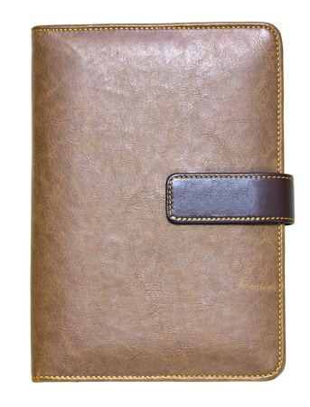 brown leather note book isolated on white background photo