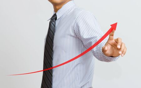 secure growth: a Business hand pressing a growth chart Stock Photo