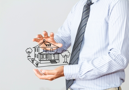 property investment: The house in human hands Stock Photo