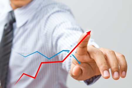 the future growth: a Business hand pressing a chart Stock Photo