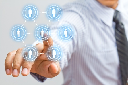 businessman touching social network structure photo