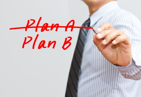 adapting: Business plan strategy changing  hand crossing over Plan A, writing Plan B  Stock Photo