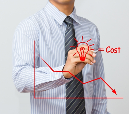 business man writing cost reduction concept Stock Photo - 15892050