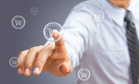 buy now: Business man pressing shopping cart icon