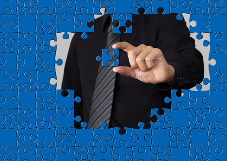 jig: puzzle piece coming down into it s place Stock Photo