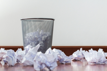 worthless: office garbage with metal basket Stock Photo
