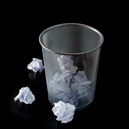 throw away: office garbage with metal basket Stock Photo