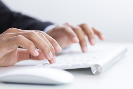 mans hands typing on keyboard  Selective focus Stock Photo