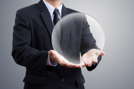 businessman Hand holding a crystal Ball Stock Photo - 18993227