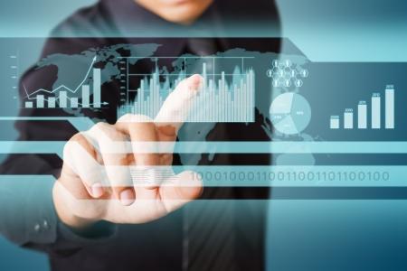 sistema: De negocios que trabaja la tecnolog�a de pantalla t�ctil wth Foto de archivo