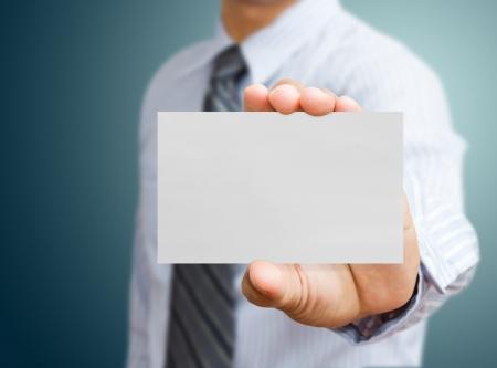 hand business card: Mano in possesso di carta bianco business