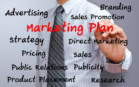 business man writing marketing plan concept Stock Photo