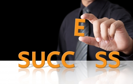 exito: Hombre de negocios y la palabra �xito Foto de archivo