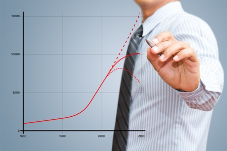 population growth: Businessman drawing world population of growth chart Stock Photo