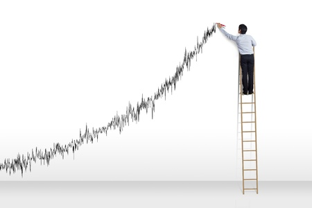 ladder of success: Businessman standing on ladder drawing diagrams and growth graph