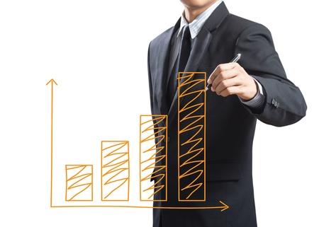upward graph: Business man drawing a growing chart