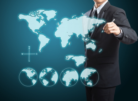 businessman drawing the world map photo