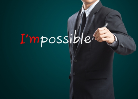 people attitude: Hand drawing and changing the word impossible to i m possible Stock Photo