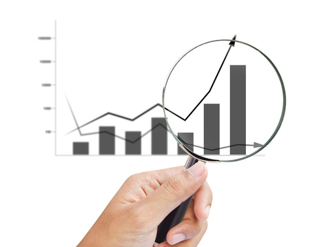 increases: magnifying glass zoom on a business chart
