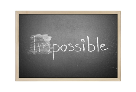Changing impossible into possible on a chalkboard Stock Photo - 20325977