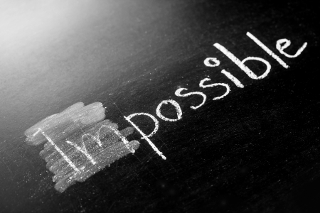 Changing impossible into possible on a chalkboard Stock Photo - 20323896