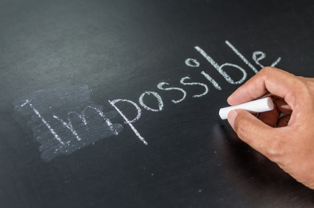 Changing impossible into possible on a chalkboard Stock Photo - 20322262