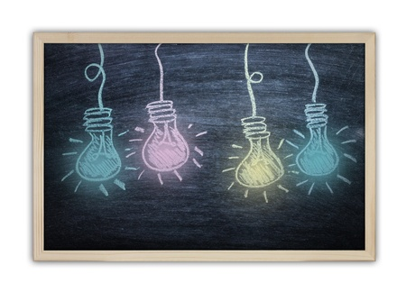 Drawing of a bulb idea on black board Stock Photo - 20325980