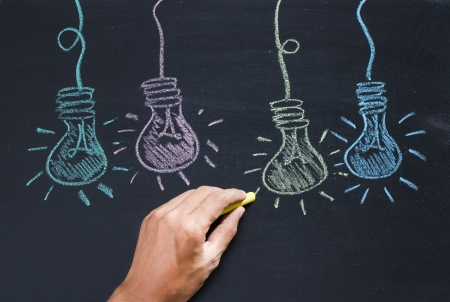 Drawing of a bulb idea on black board Stock Photo - 20325974