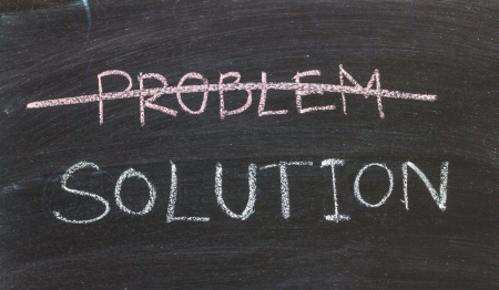 Problems Solutions handwritten with white chalk on a blackboard Stock Photo - 20325982