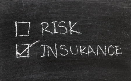 Insurance or risk on blackboard Stock Photo - 20325978