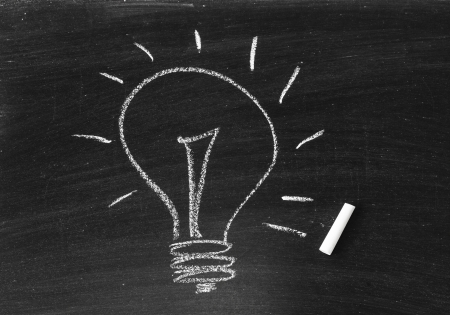 Drawing of a bulb idea on black board Stock Photo - 20325981