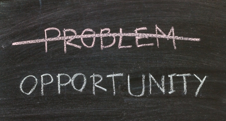 problems crossed out and opportunity on blackboard Stock Photo - 20325975