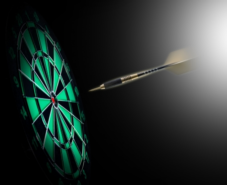 Shot of darts in bullseye on dartboard Stok Fotoğraf