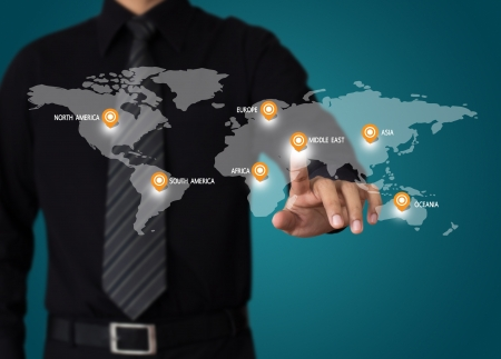 hand touch on world map for business travel concept photo