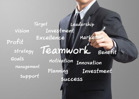 business man writing Teamwork Stock Photo - 20665860