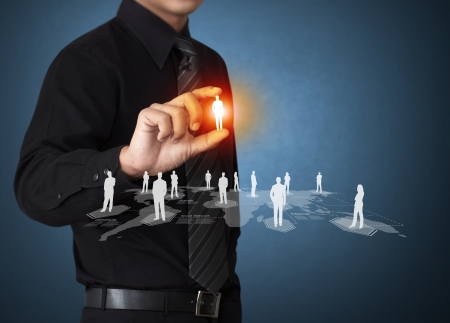 social relation: Business man holding virtual icon of social network