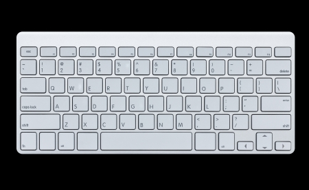 Modern computer keyboard isolated on black background photo